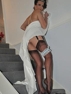 Erotic teasing is what MILF brunette does with pleasure: watch her going up-stairs, flashing with sexy ass and showing off stockings