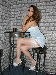Leggy lady goes to the bar dressed up like total slut hoping to seduce men with baby-doll dress, white stockings and a lot of up-skirt flashing
