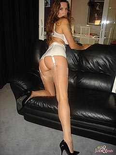 Some lucky man is getting teased by leggy Goddess in stockings: trampled at first and then fingering her pussy