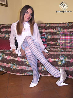 Girlfiend in happy about the way she looks in white dress and stripy stockings. Pretty innocent huh?