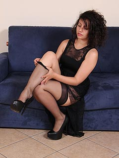 Amateur poser loves when men are becoming aroused when seeing her lovely legs in black nylon
