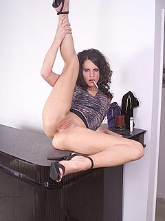 Slut is on top of the table - trying out different types of nylons while spreading really wide
