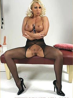 Erotic model is having a big hole in the crotch of the pantyhose - to ride the dildo with her sex-hungry cunt