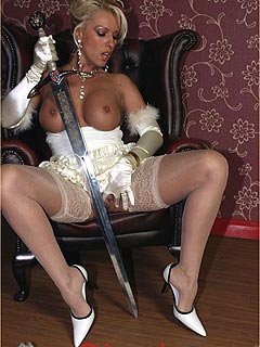 Naughty bride loves to feel the cold steel of an ancient sword with her bare pussy