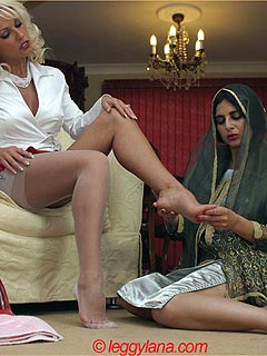 Erotic mistress is playing with her Arab maid: having her stockings removed and feet massaged