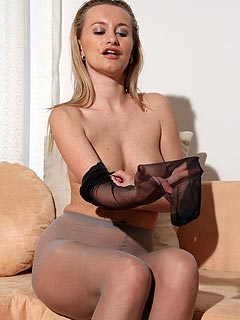 Putting black stockings on top of tan pantyhose is what makes this babe feel good and extremelt horny