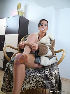 Mistress wa kind enough to let you stay in the boudoir and watch her putting on her stockings