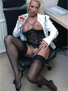 Naughty babe exposing herself behind the closed door of her office
