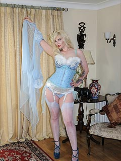Erotic mistress is in her boudoir: dressed up as lingerie princess and ready for romantic date