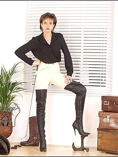 English lady is dressed for horse riding but you can have a couple of lashes of her whip too