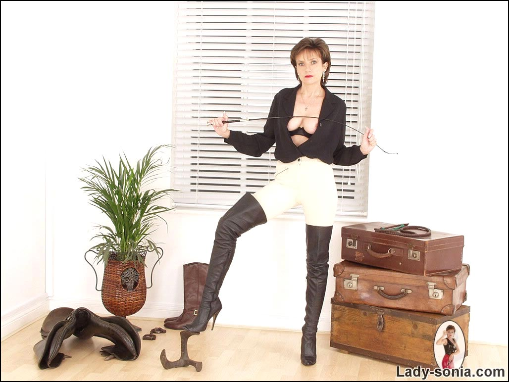 Picture 13: English lady is dressed for horse riding but you can have