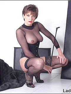 Classy lady is feeling herself as a femdom lady when wearing black nylon and tight corset