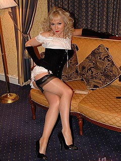Horny babe is all ready for the romantic date: dressed up in vintage-style lingerie and wearing corset