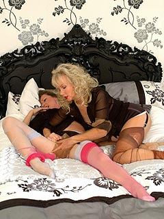 MILF lesbians enjoying each other on bed when ripping their nylon stockings
