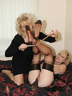 Sexy lesbians are enjoying some BDSM where one of the girls is getting tied up and then fucked with the dildo wrapped in nylon