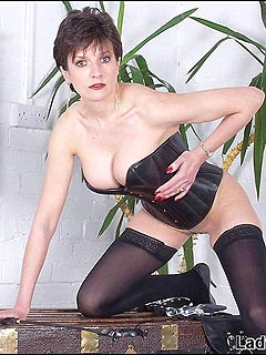 Dominatrix is going to train you dressed in just stockings and tight corset