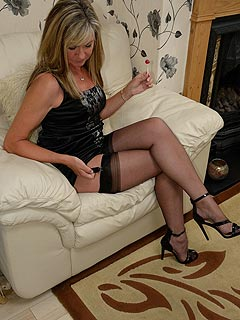 In black lingerie, stockings and a lolly-pop in her mouth this mom looks like a horny slut