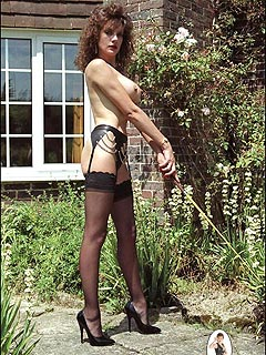 Busty dominatrix went outside topless so every neighbor would see the way she looks in tiny panties and stockings