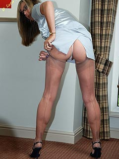 Office gal has to take care of her stockings that are sliding down all the time distracting her from the work
