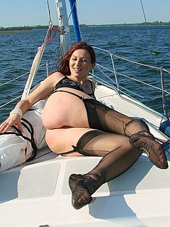 Sailing on a yaht is yet another chance for slutty redhead to show how hot her legs and feet are in black nylons