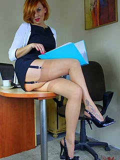 It is nice to take a break in the middle of the working day to enjoy a view os MILF secretary spreading her legs
