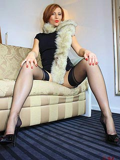 Naughty MILF is into up-skirt teasing where she shows off hot legs in seamed stockings and high heel shoes
