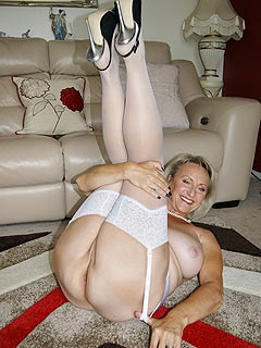 Fingering herself in white nylons in front of the camera is what granny enjoys doing