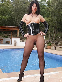 PVC gloves and tight corset are joining the black pantyhose forming the fetish outfit leggy babe is posing in at the pool