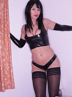 Wearing tight PVC lingerie and black stockings is a nice type of outfit for slut to seduce a man