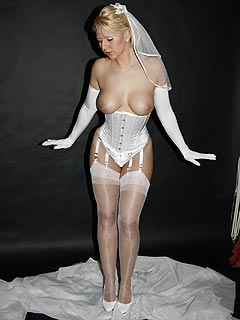Slut is ready for the wedding ceremony: going topless in just tight corset and a pair of nylons
