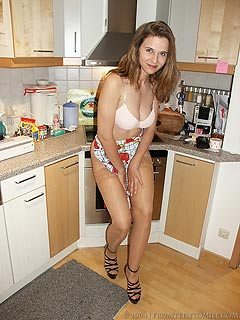 Cooking in stockings and an apron is the new kinky thing naughty housewife is enjoying when home alone