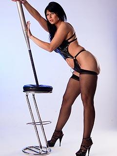 Desyra Noire is doing erotic posing in fetish type of lingerie, wearing a apir of black stockings and with a baseball bat in her hands