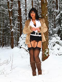 It is a little bit unusual when hot gal goes to the woods in the middle of the winter to do stripping and pose in stockings