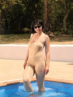 Swimming in the pool in a full-body nylon suit is not just feels good for hot MILF but also looks sexy