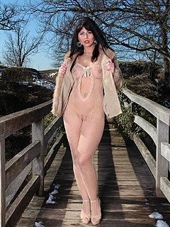 it is winter outside but that does not mean hot slut cannot go for a stroll in just see-though fishnet body suit and heels