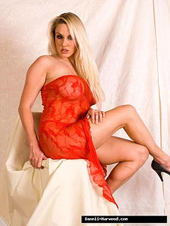 Erotic model takes down red lace dress to show you a pair of sexy hips and long legs