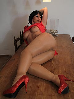 It means a lot of sexy up-skirt and leg pictures when hot woman goes on top of the table in pantyhose and heels
