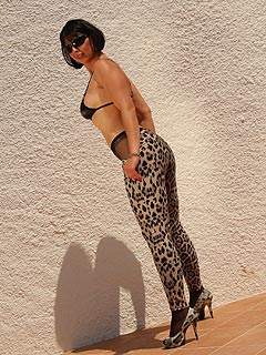 Expect to enjoy a view of sexy pantyhosed ass and hot legs once those leopard print leggings are pulled down by the MILF
