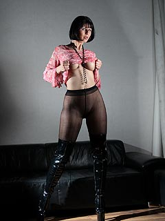It only takes leather boots and black pantyhose for busty girl to dress up really slutty
